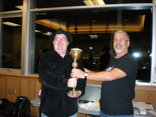 Mike Frentz receives trophy from Tournament Director John Aitken